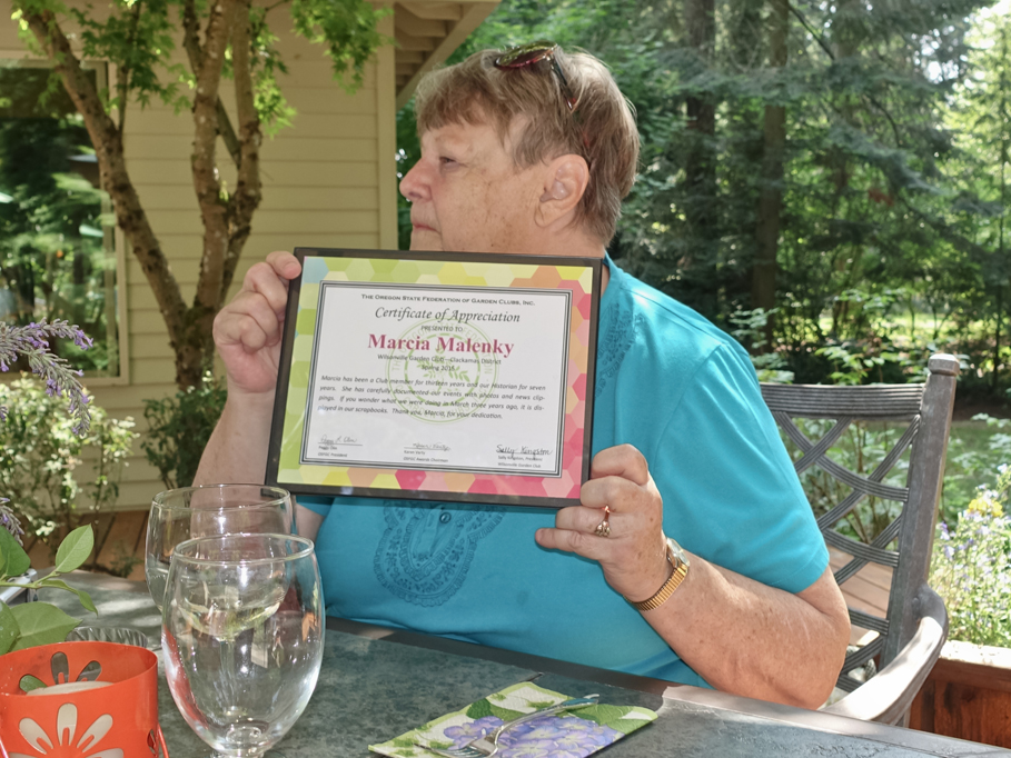 Retiring historian, Marcia Malenky receives award.