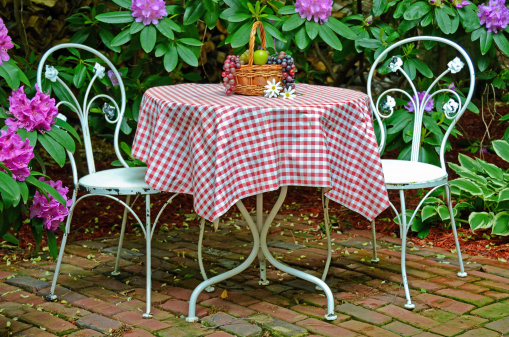 old table and chairs in garden
