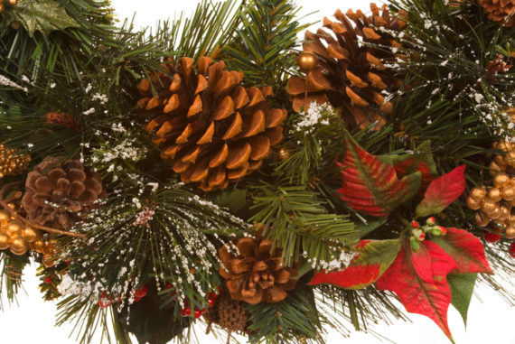 Christmas wreath with pine cones, ornaments, ribbons, poinsettias, berries
